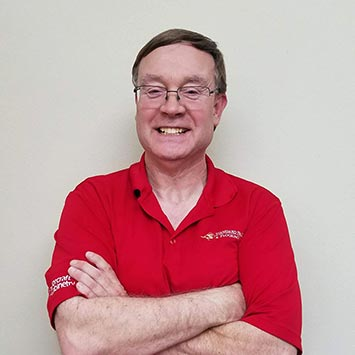Dan Goodfellow wearing a red polo shirt at Standard Paint & Flooring's Wenatchee, WA location.