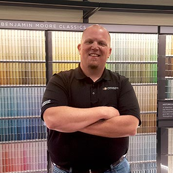 Jeff Coleman standing in front of a paint color chip wall at Standard Paint & Flooring in Richland, WA location.