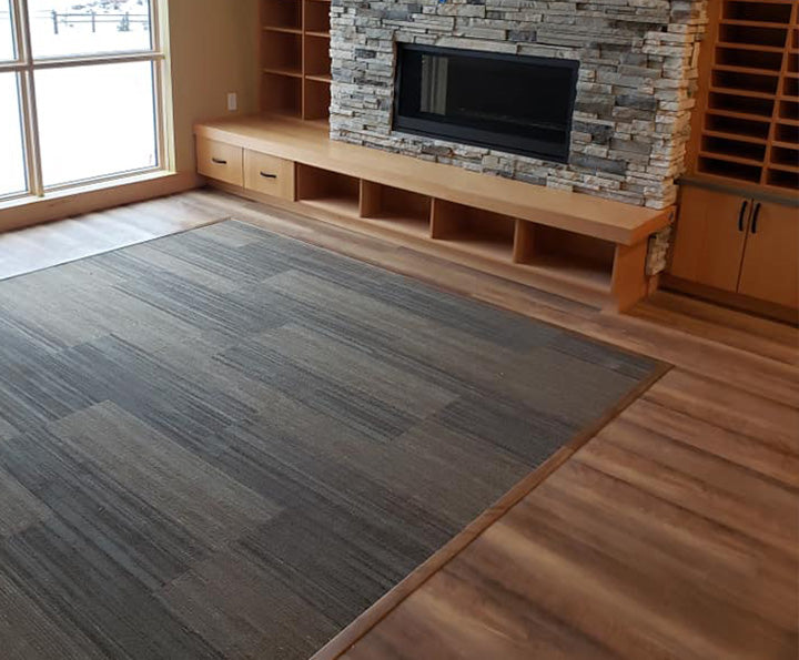 Bedroom floor with Shaw inspiration hardwood in hickory, available at Standard Paint & Flooring