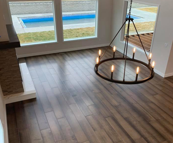 Living room floor with Shaw inspiration hardwood in maple, available at Standard Paint & Flooring