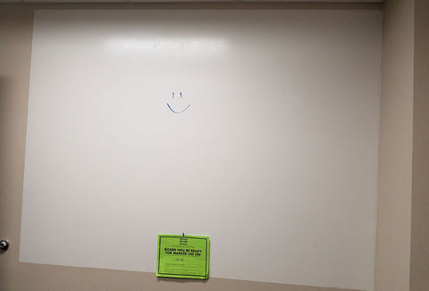 Dry erase board that has been painted using dry erase paint.