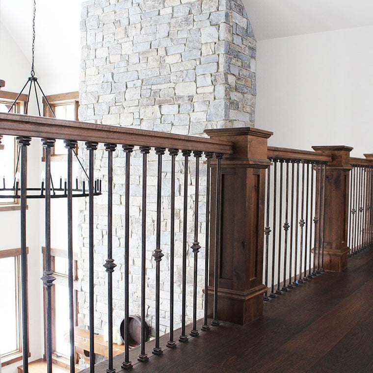 custom wood railing, with iron ballusters by Modern Millwork