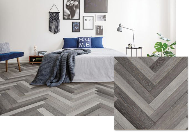 A bedroom with COREtec click and lock Herringbone enhanced planks, available at Standard Paint & Flooring.