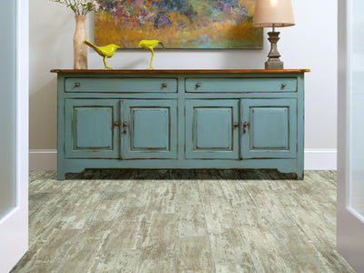 Room Image of Shaw Floors Champion Plank Resilient Residential Unit flooring in the color Medalist                       available at Standard Paint and Flooring.
