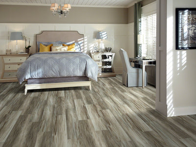 Room Image of Shaw Floors Champion Plank Resilient Residential Unit flooring in the color Willpower                      available at Standard Paint and Flooring.