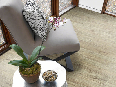 Room Image of Shaw Floors Champion Plank Resilient Residential Unit flooring in the color Sprint                         available at Standard Paint and Flooring.