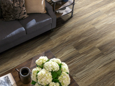 Room Image of Shaw Floors Champion Plank Resilient Residential Unit flooring in the color Marathon                       available at Standard Paint and Flooring.