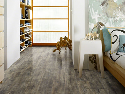 Room Image of Shaw Floors Champion Plank Resilient Residential Unit flooring in the color Sponsor                        available at Standard Paint and Flooring.