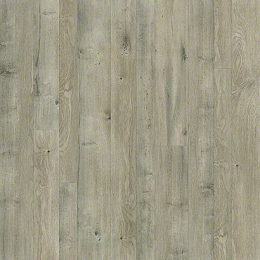 Product sample of Shaw Floors Castle Ridge Style laminate flooring in the color Alloy available at Standard Paint and Flooring.