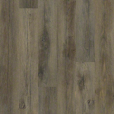 Product sample of Shaw Floors Grand Mountain Style laminate flooring in the color Tavern Brown Oak available at Standard Paint and Flooring.