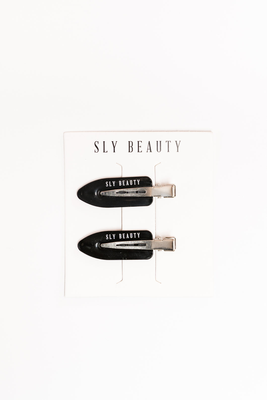 FREE SLY BEAUTY HAIR CLIPS WITH PURCHASE