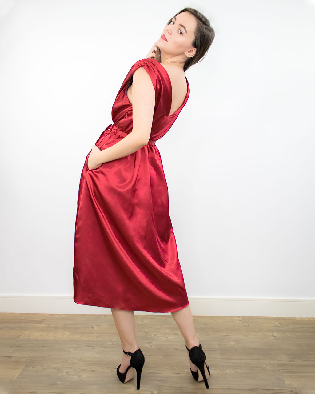Sustainable ethical satin silk red wrap ruched dress for formal cocktail party or wedding with belt made from recycled PET