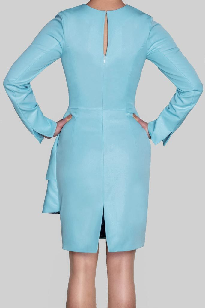 Back view of ADKN Abel baby blue Dress with sleeves and keyhole detail and slit made in UK from sustainable recycled bottles