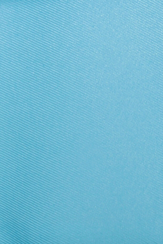 Sustainable pastel blue gabardine made from recycled plastic bottles for Abel Dress by ADKN