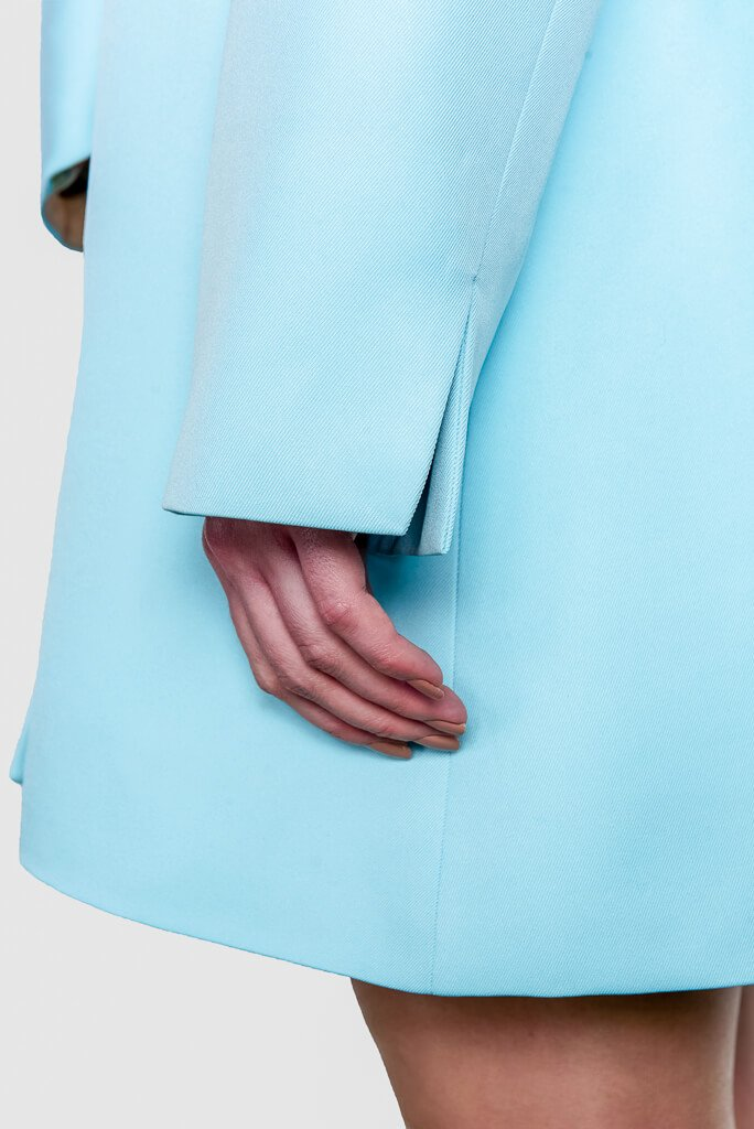 Pale blue sustainable gabardine Cardea Coat by ADKN sleeve detail