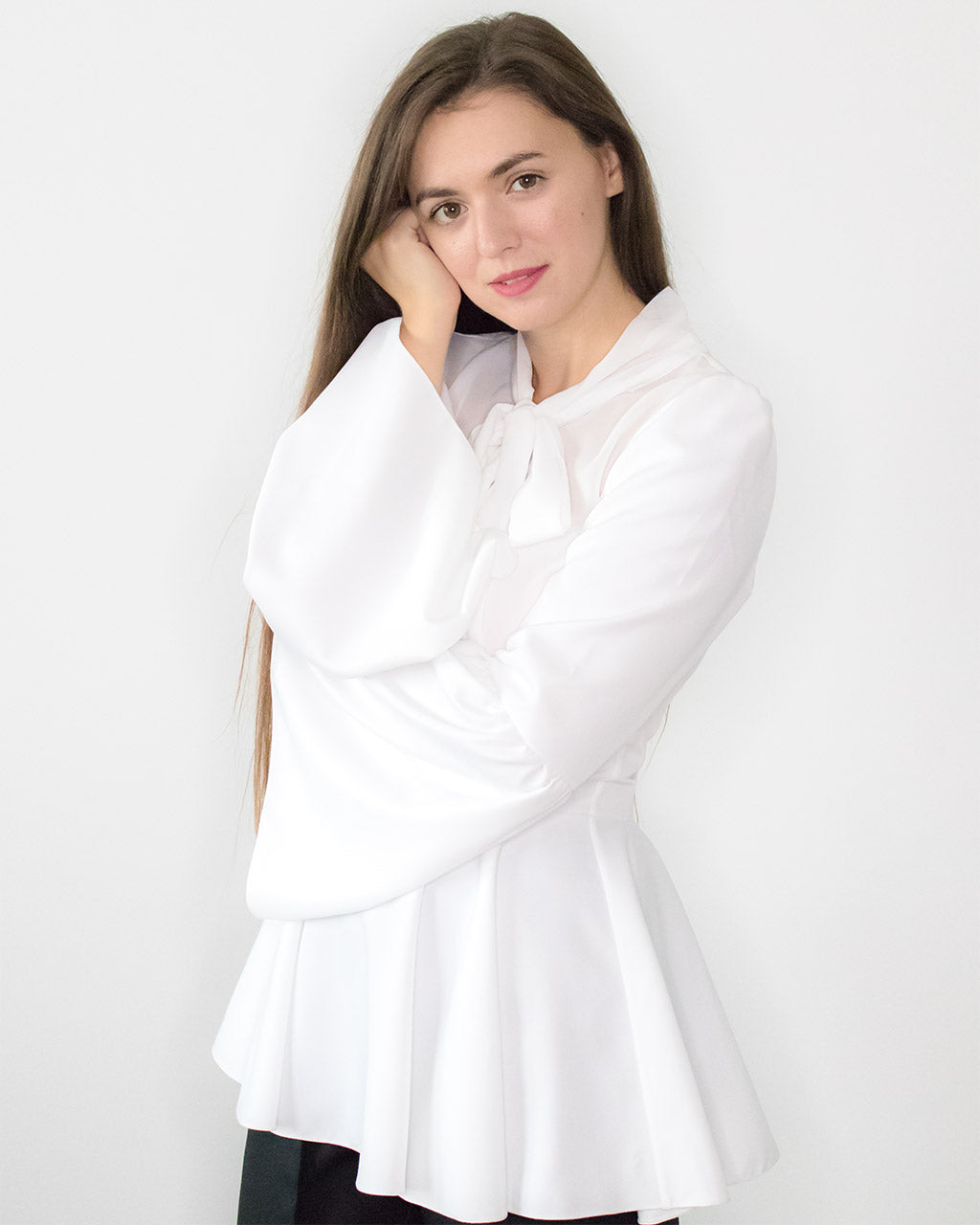 Ethical designer white peplum bell sleeves top with bow ADKN fit & flare occasion evening blouse made from recycled PET UK