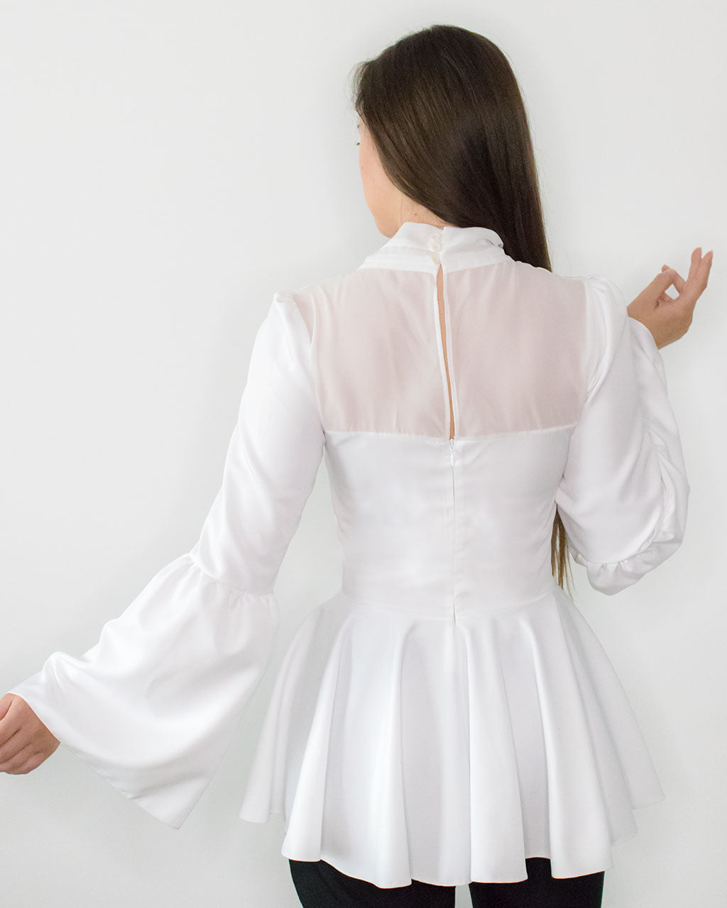 Back of designer white fit & flare recycled chiffon classy blouse with high neck and key hole ethically made in UK by ADKN