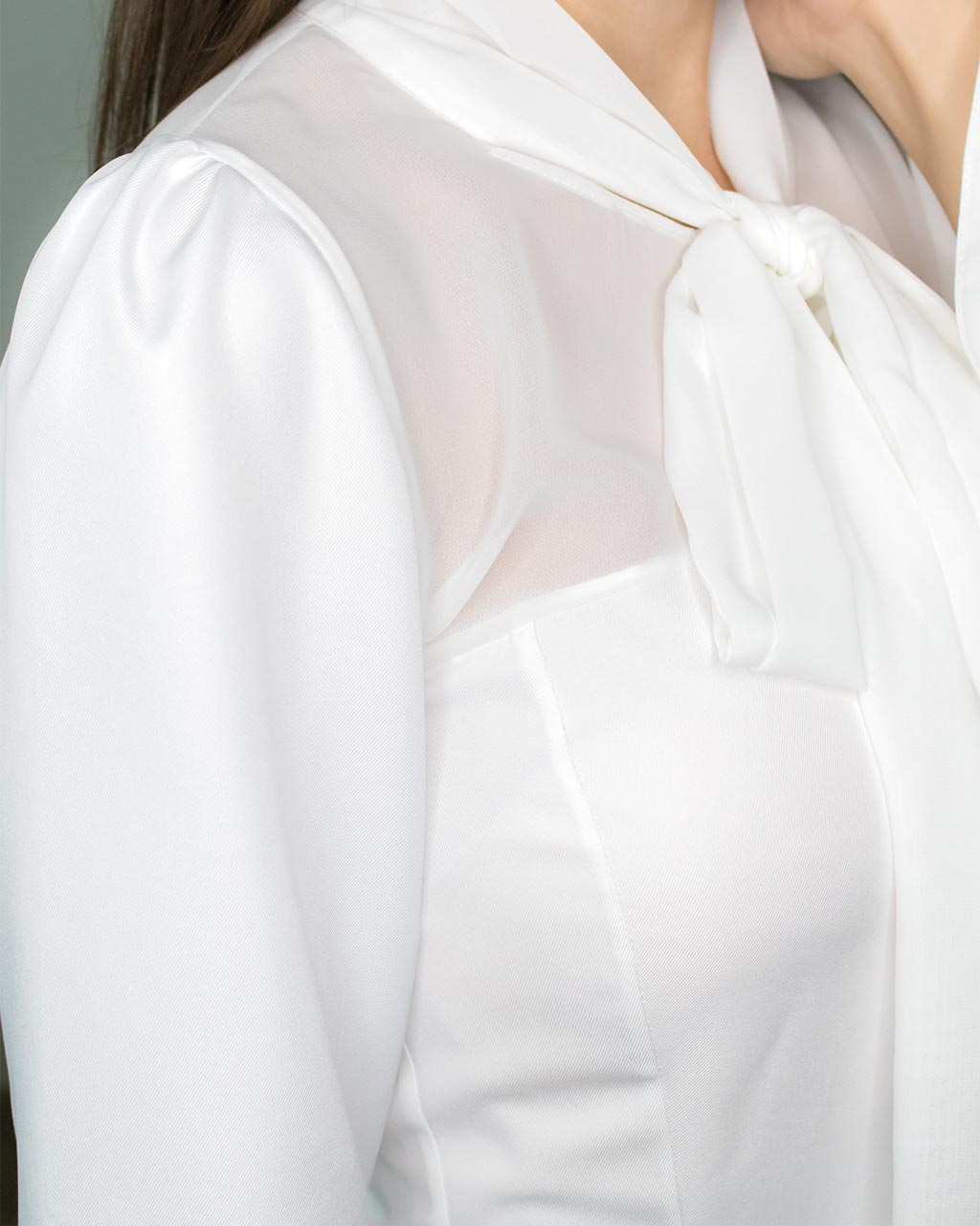 Classy elegant shoulder detail of white party going out office work peplum blouse by ADKN made from recycled PET bottles