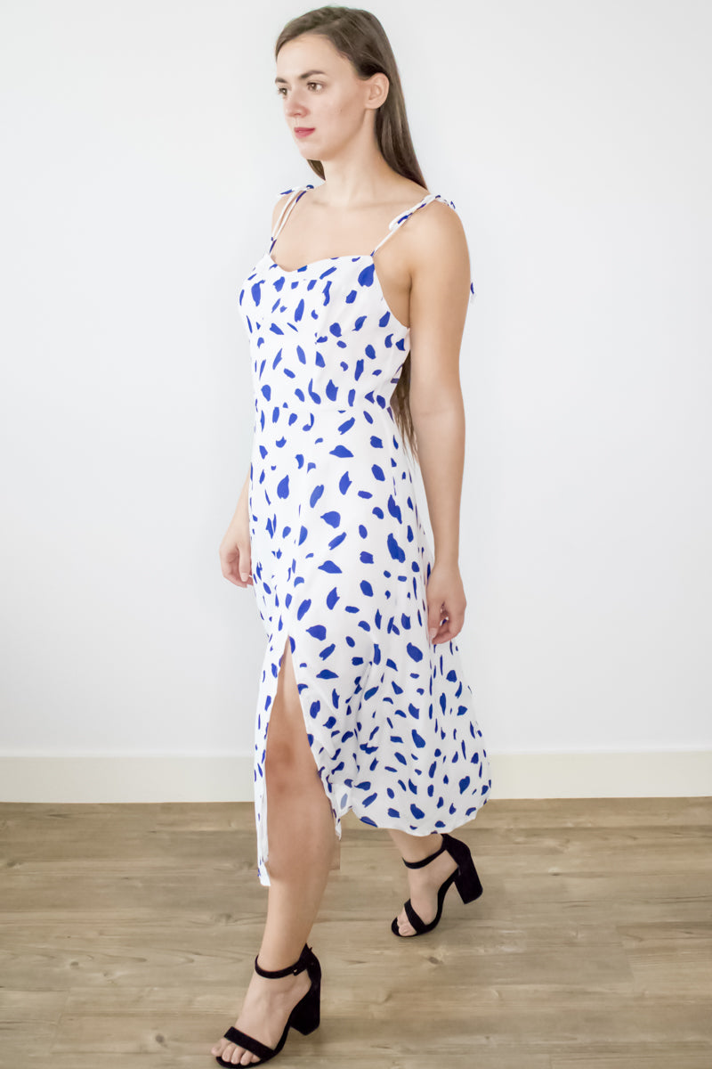 Sustainable upcycled summer party white polka dot midi dress with sweetheart neck tie straps and thigh slit by ADKN DLife UK