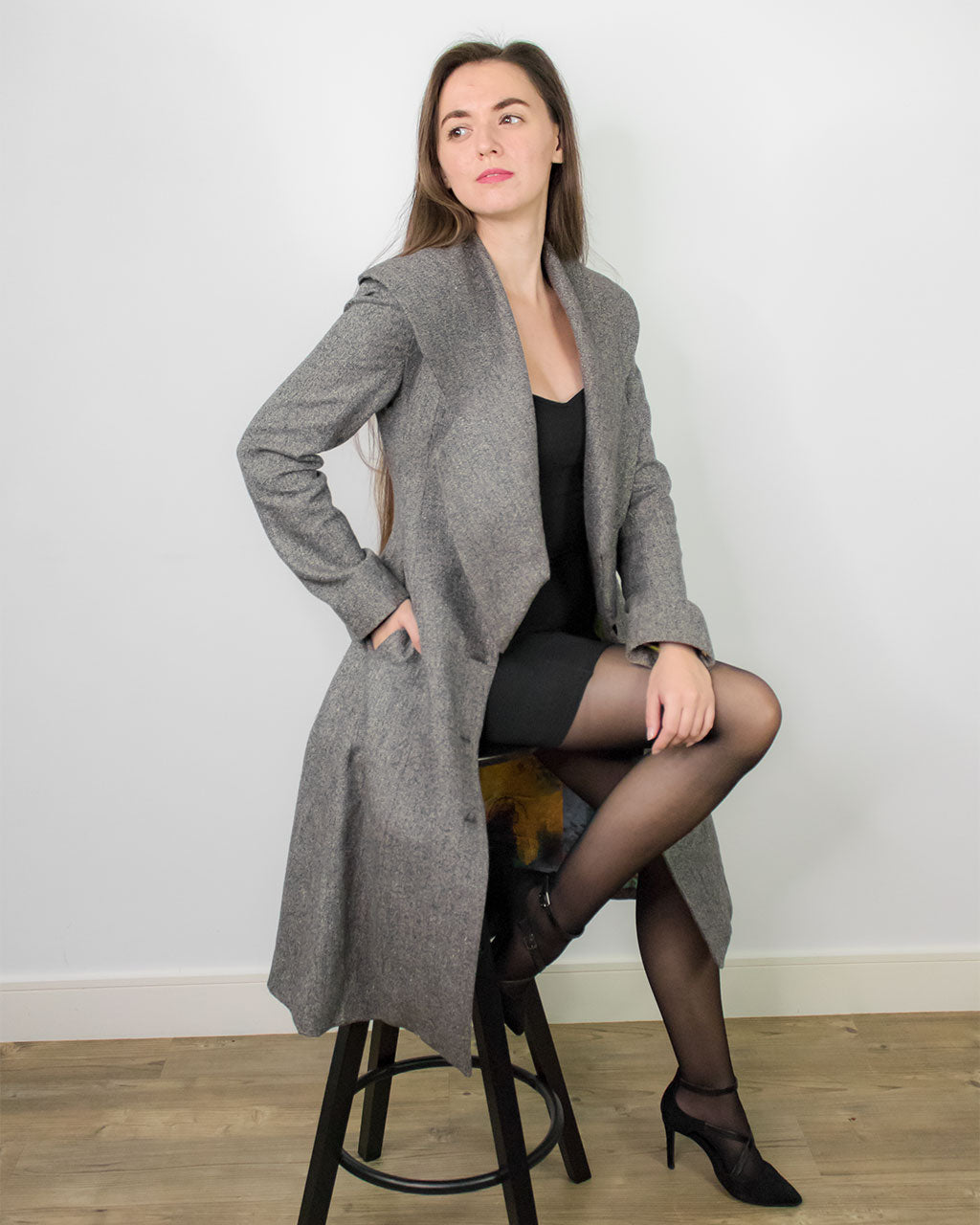 Profile view of tweed grey wool hemp Baldo swing flare Coat by ADKN made from light sustainable materials perfect for spring