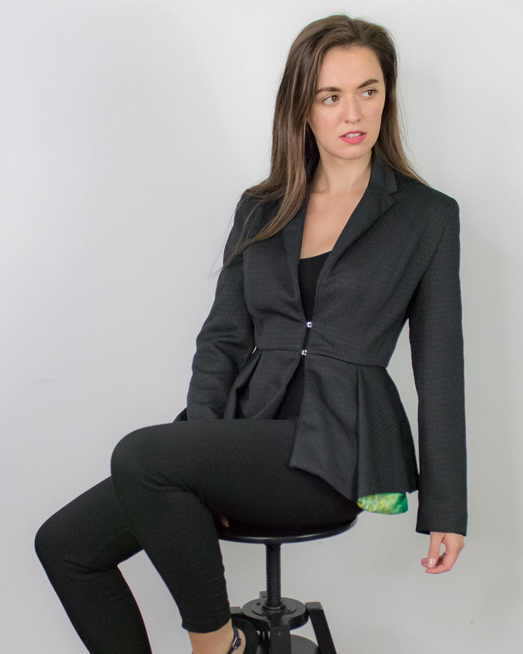 Designer sustainable black fitted peplum blazer ladies tailored jacket by ADKN ethically made in UK from recycled PET bottles