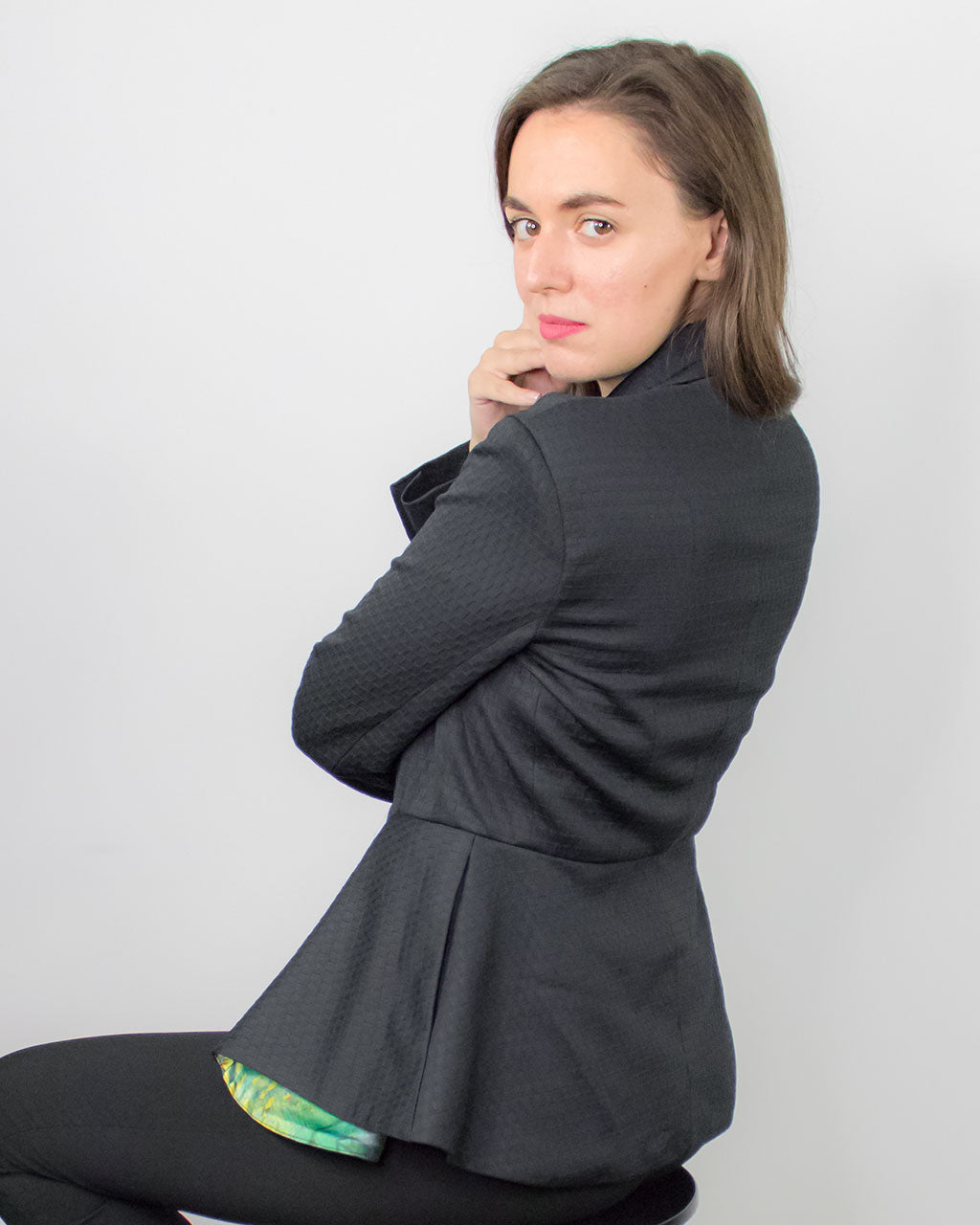 Sustainable basics by ADKN a smart peplum fitted tailored black blazer jacket with pockets made from recycled plastic bottles