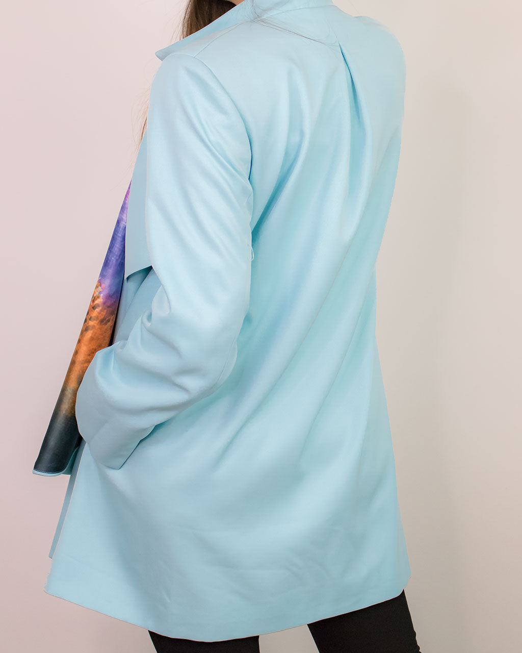 Back view of oversized blue coat ADKN