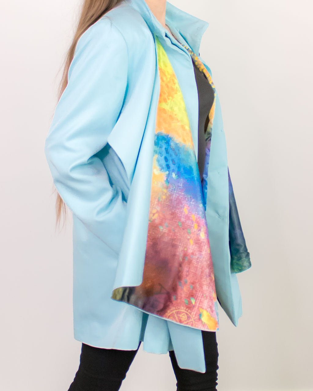 Side view of a line oversized pastel light blue print satin scarf gabardine Mac coat Cardea by ADKN perfect for spring