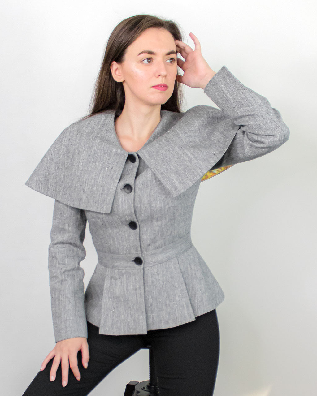 Peplum and cape detail of fitted Abbe Jacket with Corozo buttons by ADKN made from grey hemp perfect for office