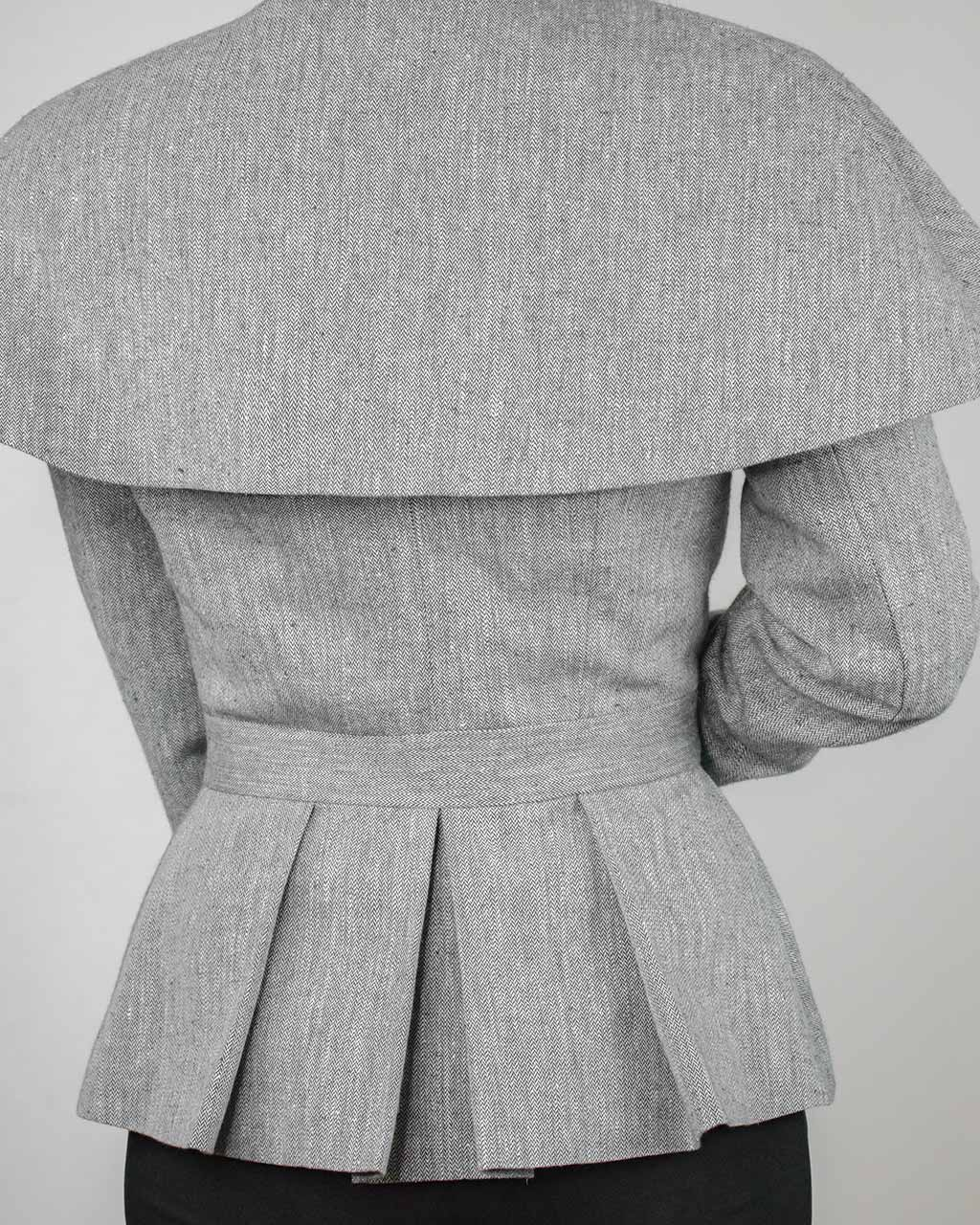 Back detail of cape and structured peplum of ethical Abbe Jacket fitted blazer by ADKN