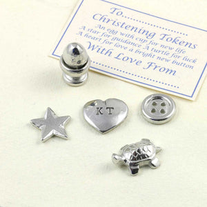 A personalised pewter christening token set