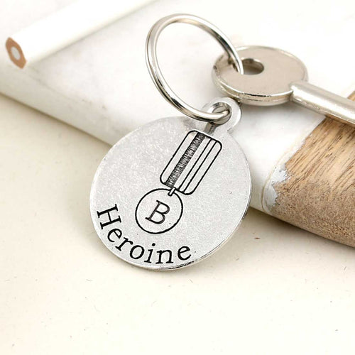 You Are Our Heroine Round Pewter Keyring - Multiply Design