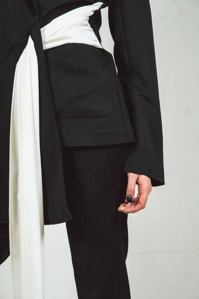Black blazer with a white tie