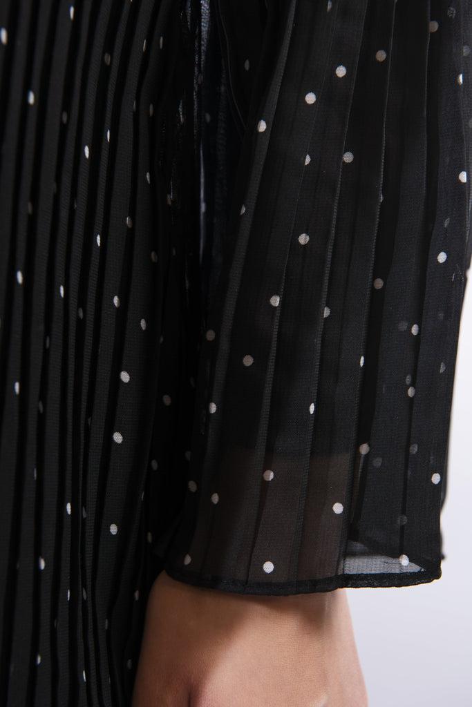 Black dress with white polka dot detail