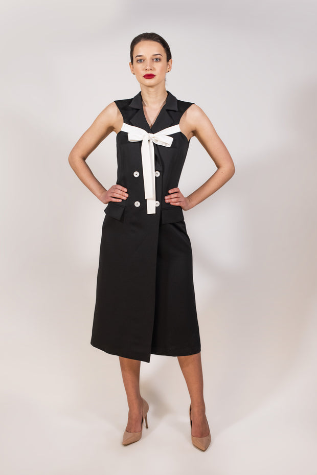 Black vest with white tie knot