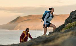 Smartwool woman and man backpacking