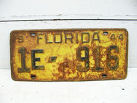 Vintage Retired Florida License Tag Plate - 1944 Yellow 1E 916 Rusty - Free Ship - idugitup