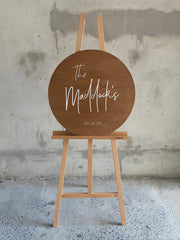 wooden round surname sign