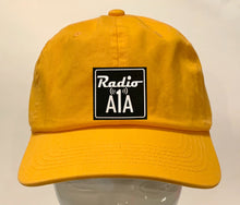 "Load image into Gallery viewer, Buddha gear yellow dad hat Radio A1A Headwear, Key West Florida ""Music For The Road To Paradise""  Make sure to tune in when you're driving through the Keys! Even when your'e not, you can tune into their web radio at www.radioa1a.com"