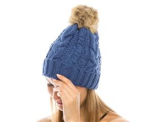 Blue Fur pom pom cable knit beanie hats.  Cozy plush lining Detachable snap-on faux fur pom Super warm Buddha Beanies By Buddha Gear. Also available with Namaste, Lotus, Om, Unicorn, Tree of Life, Compass, Infinite Heart, Moons and Phoenix patches