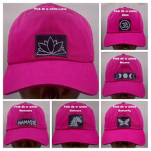 Load image into Gallery viewer, Buddha lids Buddha gear Hot pink dad hat with handmade lotus patch  The lotus has long been regarded as sacred by many of the world's religions, especially in India and Egypt, where it is held to be a symbol of the Universe itself. Rooted in the mud, the lotus rises to blossom clean and bright, symbolizing purity and resurrection  In Buddhist symbolism the lotus is symbolic of purity of the body, speech, and mind while rooted in the mud, its flowers blossom on long stalks as if floating above the muddy wate