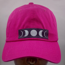 Load image into Gallery viewer, Buddha Gear Buddha Lids Flexible cotton hot pink dad hat with moon phase patch  Who isn't mesmerized by the moon? the Moon inhabits the landscapes of the soul, emotions, and dream life 🌕❤️  The moon is a feminine symbol, universally representing the rhythm of time as it embodies the cycle. The phases of the moon symbolize immortality and eternity, enlightenment or the dark side of Nature herself.