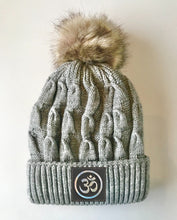 Load image into Gallery viewer, Grey plush pom pom beanie hat with Om vegan leather by buddha gear