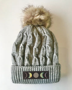 Grey plush pom pom beanie hat with moons by buddha gear