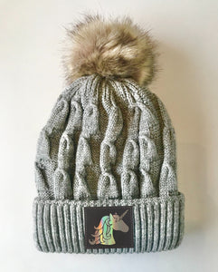 Grey plush pom pom beanie hat with unicorn vegan leather by buddha gear