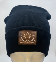 Load image into Gallery viewer, Buddha gear Buddha beanies Black Buddha Beanie with a Lotus over your Third Eye   The lotus has long been regarded as sacred by many of the world's religions, especially in India and Egypt, where it is held to be a symbol of the Universe itself. Rooted in the mud, the lotus rises to blossom clean and bright, symbolizing purity and resurrection