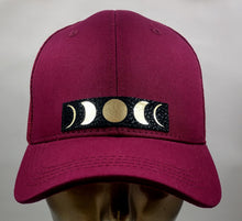 Load image into Gallery viewer, Buddha Gear Buddha Lids Burgundy snapback with hand made moon phase patch. Buddha wear  - Who isn't mesmerized by the moon? the Moon inhabits the landscapes of the soul, emotions, and dream life 🌕❤️  The moon is a feminine symbol, universally representing the rhythm of time as it embodies the cycle. The phases of the moon symbolize immortality and eternity, enlightenment or the dark side of Nature herself. Buddha wear