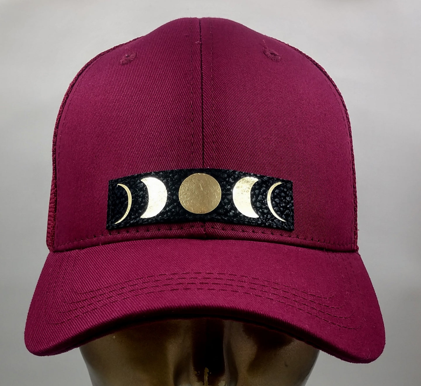 Buddha Gear Buddha Lids Burgundy snapback with hand made moon phase patch. Buddha wear  - Who isn't mesmerized by the moon? the Moon inhabits the landscapes of the soul, emotions, and dream life 🌕❤️  The moon is a feminine symbol, universally representing the rhythm of time as it embodies the cycle. The phases of the moon symbolize immortality and eternity, enlightenment or the dark side of Nature herself. Buddha wear