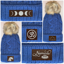 Load image into Gallery viewer, Buddha Gear Plush Blue, Blanket Lined Cable Knit, Pom Pom Beanie with Unicorn, Om, Phoenix, Namaste, Lotus, Tree of Life, Moons, Infinite Heart or Cristian Fish/ichthus Buddha Wear Buddha Beanies