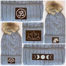Load image into Gallery viewer, Buddha gear Plush Grey, Blanket Lined Cable Knit, Pom Pom Beanie with Unicorn, Om, Phoenix, Namaste, Lotus, Tree of Life, Moons, Infinite Heart or Cristian Fish/ichthus, Buddha and more...  Buddha Wear Yoga Wear Buddha beanies